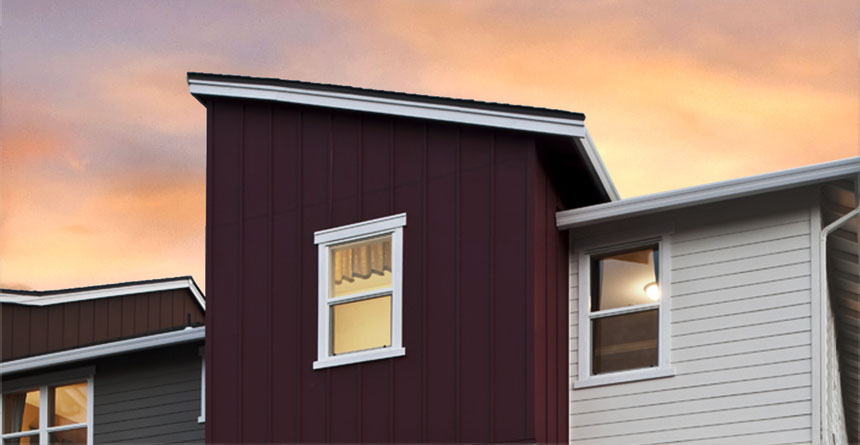 A dramatic HardiePanel® Vertical Siding Home
